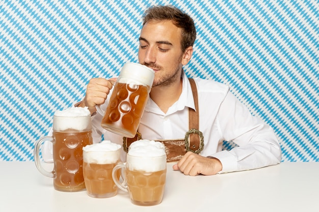 Front view of man drinking blonde beer