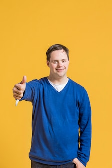 Front view of man giving thumbs up