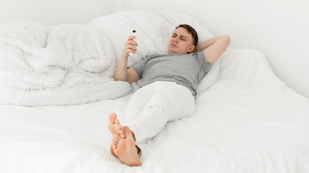 Front view of man having fun at home