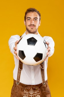 Front view of man holding ball