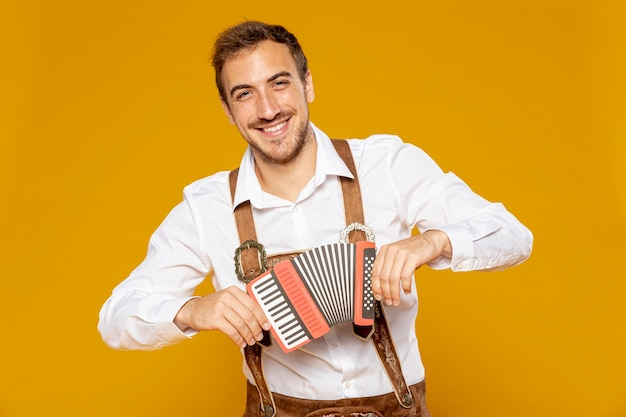 Front view of man holding bandoneon