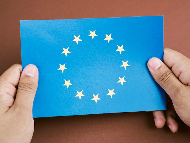 Front view man holding a card with the european union flag