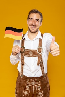 Front view of man holding german flag