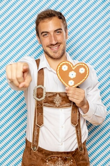Front view of man holding gingerbread