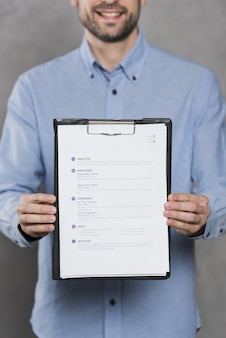Front view of man holding his resume