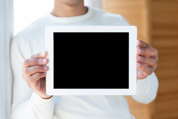 Front view of man holding tablet mock-up