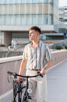 Front view of man outdoors with bicycle