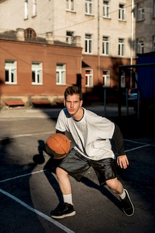 Front view man playing basketball