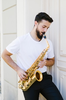 Front view man playing the saxophone