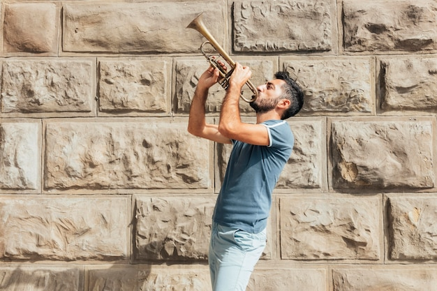 Front view of man playing the trumpet