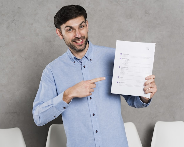 Front view of man pointing at contract