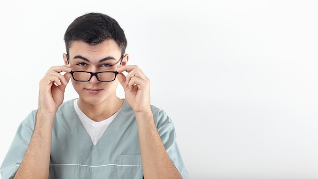 Front view of man posing with glasses and copy space