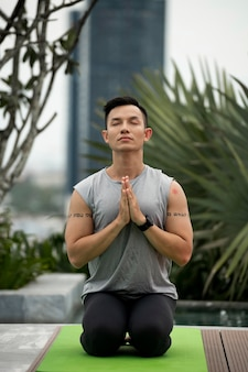 Front view of man practicing yoga