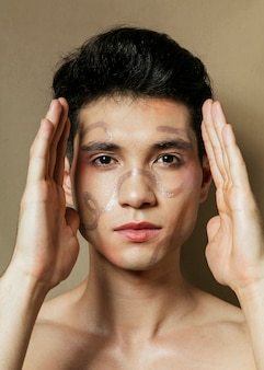 Front view of man putting hands next to face
