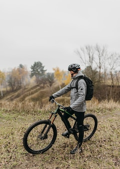 Front view of man riding a bike in mountain