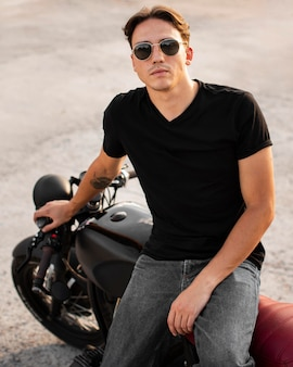 Front view man sitting on motorcycle
