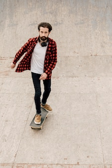 Front view of man skateboarding