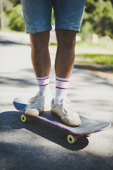 Front view of man standing on skateboard