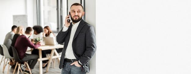 Front view of man talking at phone