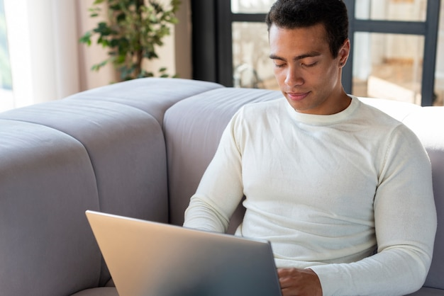 Front view of man using laptop