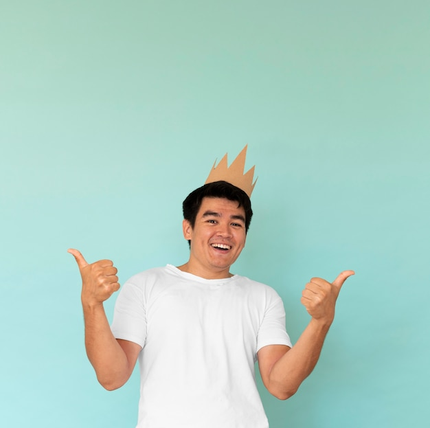 Front view of man wearing a crown with copy space