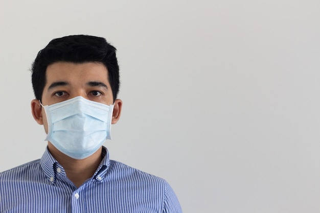 Front view of man wearing a medical mask copy space for text