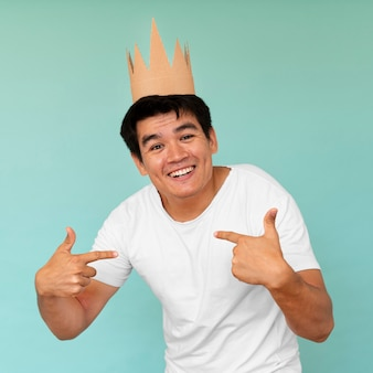 Front view of man with crown concept