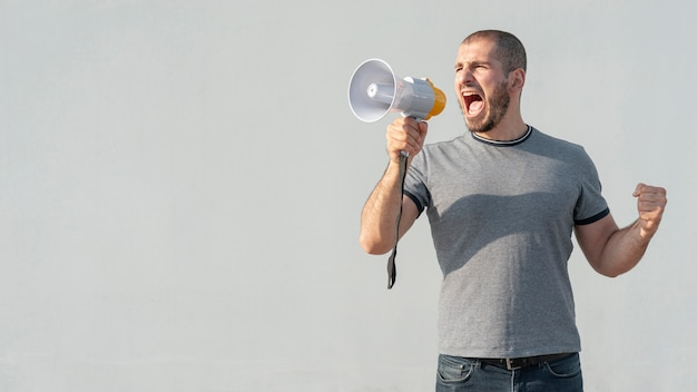Front view man with megaphone shouting