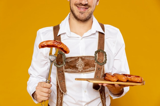 Front view of man with sausages tray