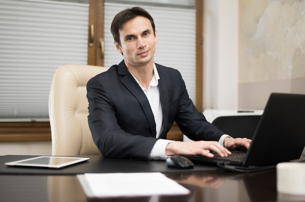Front view of man working on laptop