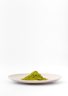 Front view matcha tea powder on a plate