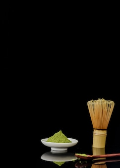 Front view of matcha tea powder with copy space