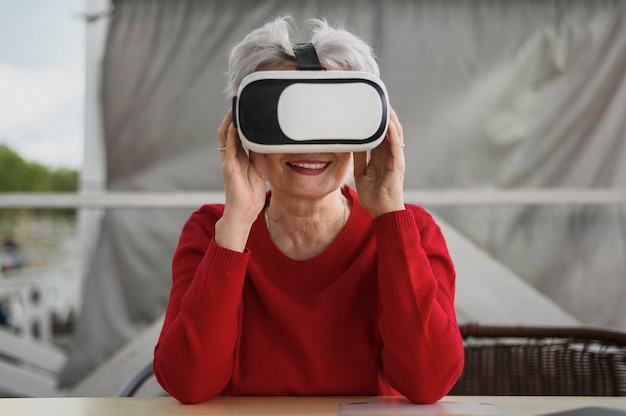 Front view mature woman trying a vr
