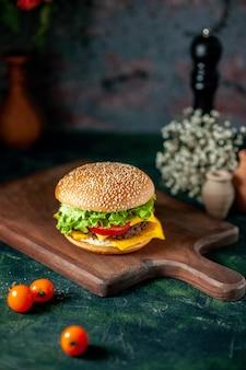 Front view meat hamburger on dark background
