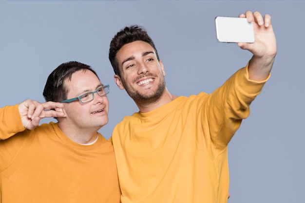 Front view men taking a selfie together