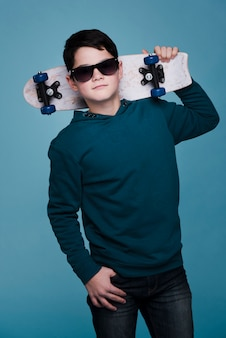 Front view of modern boy with sunglasses posing