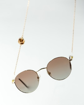 A front view modern dark sunglasses on the white