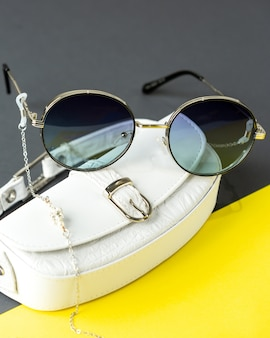 A front view modern dark sunglasses on the yellow-black