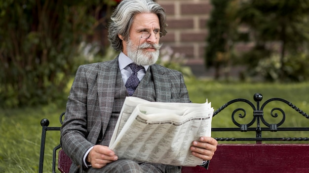 Front view modern man reading newspaper