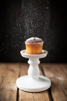 Front view muffin with powdered sugar