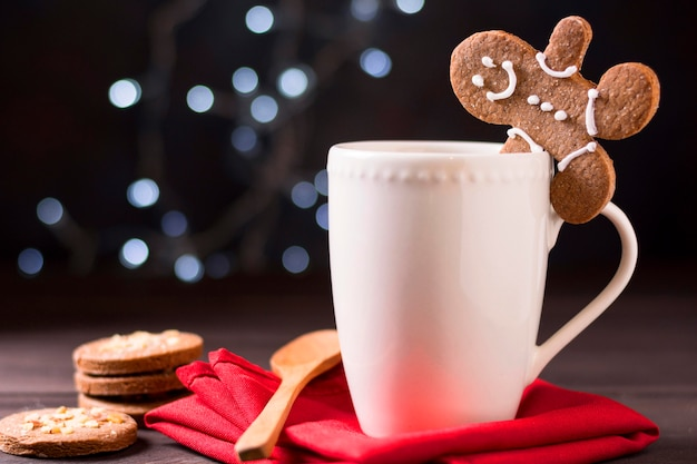 Front view of mug with gingerbread man and biscuits