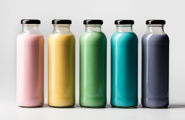 Front view of multicolored juice bottles