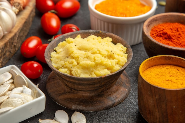 Front view mushed potatoes with seasonings and tomatoes on grey background color meal pie ripe product