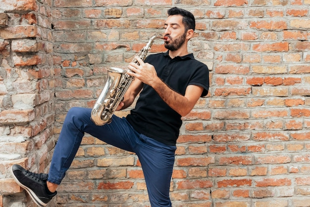 Front view of musician playing saxophone concept