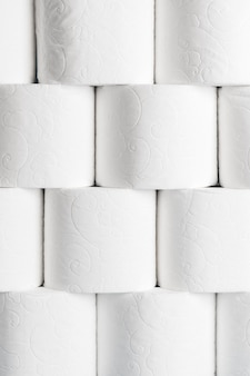 Front view of neatly stacked toilet paper rolls