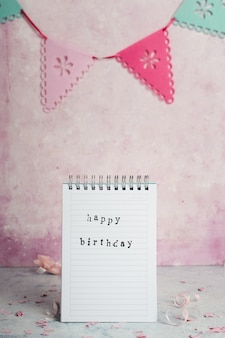 Front view of notebook with happy birthday wish and garland