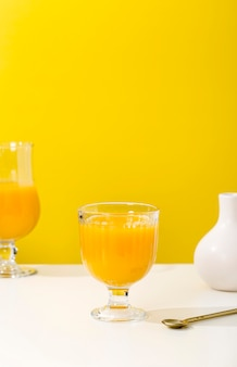 Front view nutritious orange smoothie arrangement