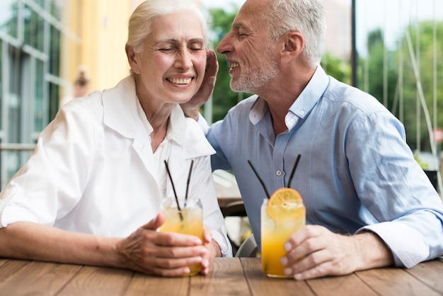 Front view old couple spending time together