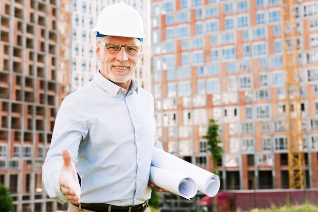 Front view old man with protection helmet and glasses