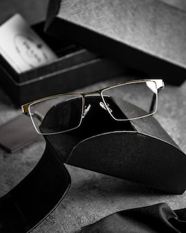A front view optical sunglasses modern on the grey desk isolated sight vision eyes